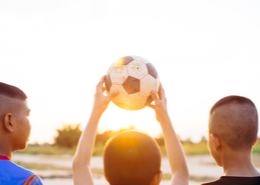 Students holding a football