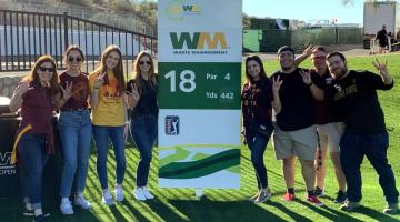 ASU students and faculty member Erin Schneiderman on the 18th hole
